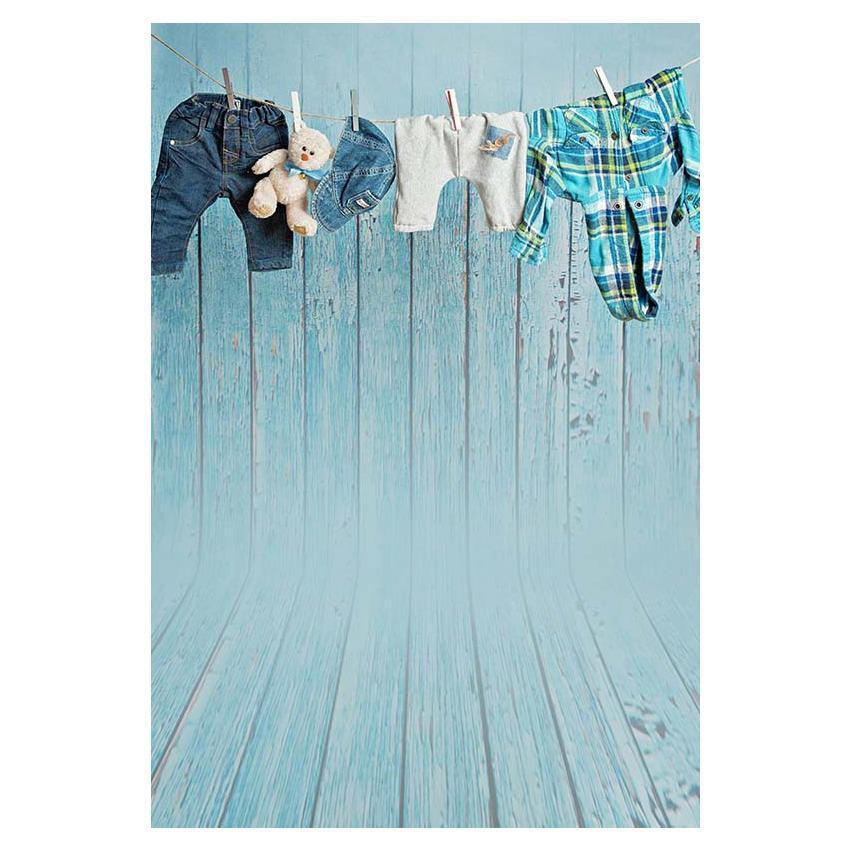 Hanging Clothes Before Blue Wood Wall Backdrop for Photography