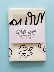 Melbourne 'four seasons in one day' Tea Towel