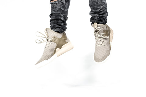 71d2a2b56600 Adidas Tubular Mid top is the first instalment of this shoe and a premium  colour way. Knitted upper and full grain leather heel strap.