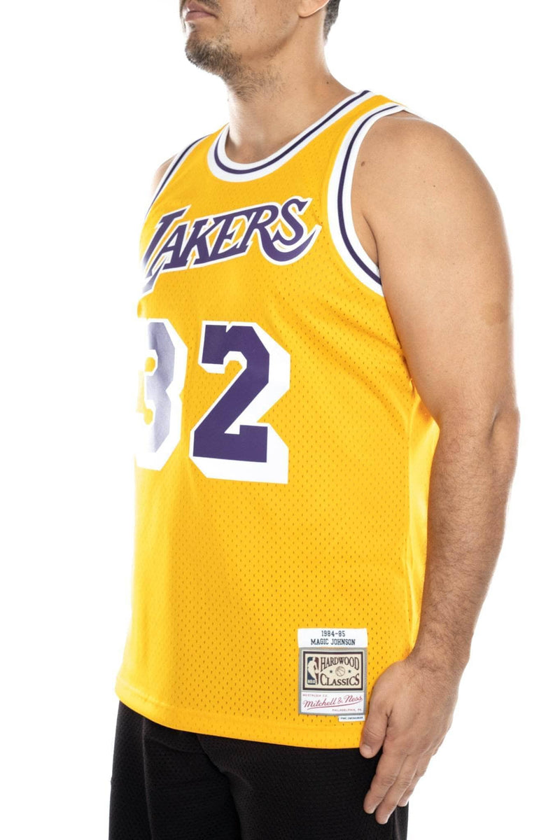 2dae0b349be mitchell and ness magic johnson 32 84-85 swingman jersey | trainers