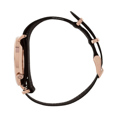 Rose gold and black watch with a soft black nato band and rose gold black buckle designed by THE HOUND, styled done up and shot from a side on angle.