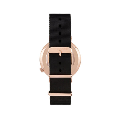 Rose gold and black watch with a soft black nato band and rose gold black buckle designed by THE HOUND, styled done up and shot from behind.