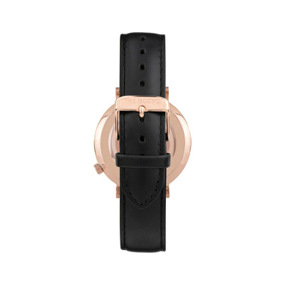 Rose gold and white watch with a stitched black genuine leather band and rose gold black buckle designed by THE HOUND, styled done up and shot from behind.