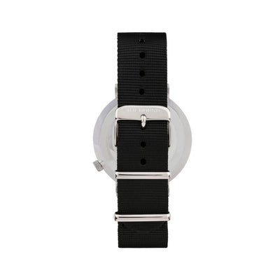 Silver and white watch with a soft black nato band and silver black buckle designed by THE HOUND, styled done up and shot from behind.