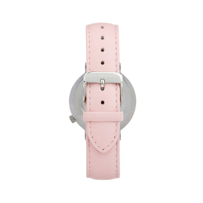 Silver and white watch with a stitched blush pink genuine leather band and silver black buckle designed by THE HOUND, styled done up and shot from behind.