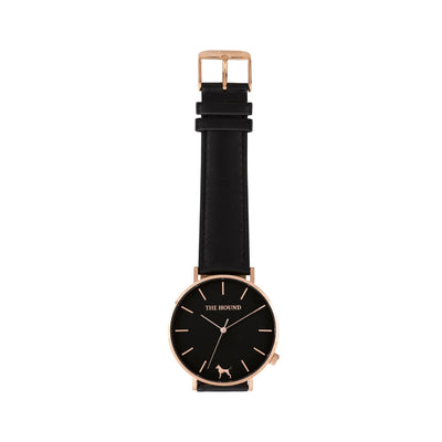 Rose gold and black watch with a stitched black genuine leather band and rose gold black buckle designed by THE HOUND, styled flat and shot from above.