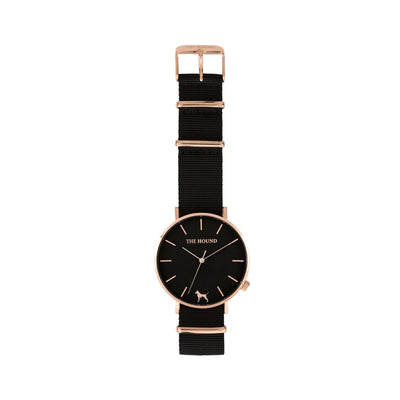 Rose gold and black watch with a soft black nato band and rose gold black buckle designed by THE HOUND, styled flat and shot from above.