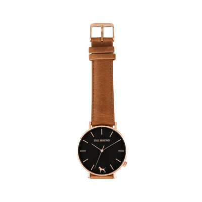 Rose gold and black watch with a stitched tan genuine leather band and rose gold black buckle designed by THE HOUND, styled flat and shot from above.