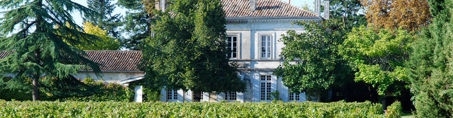 The Château Dutruch Grand Poujeaux with vineyards to the front