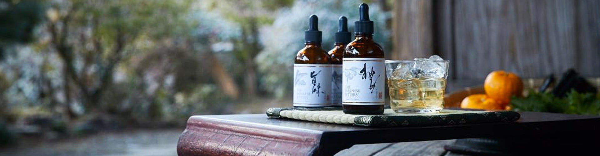 Beauty shot of The Japanese Bitters on serving tray with cocktail