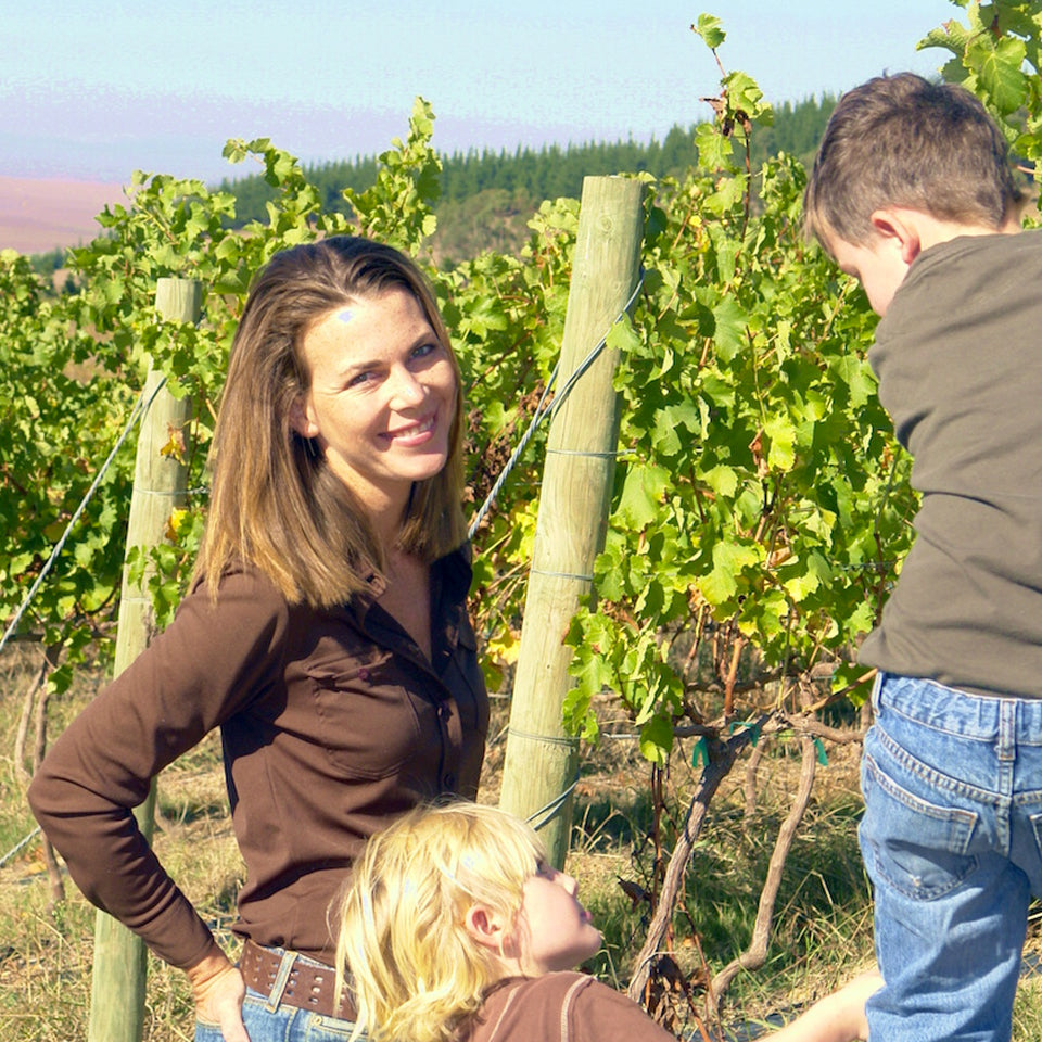 Samantha O'Keefe and her young sons in the vineyard