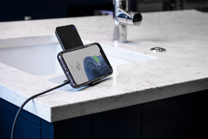 wireless charging bank next to sink