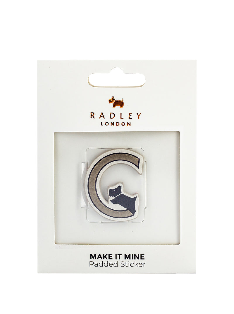 RADLEY 'MAKE IT MINE' PHONE STICKER - GOLD