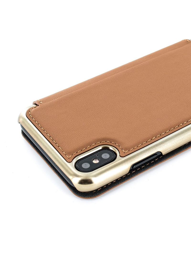 Detail image of the Greenwich Apple iPhone XS Max phone case in Saddle Brown