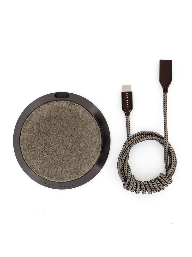 Package contents image of the Ted Baker Universal wireless charger in Brown