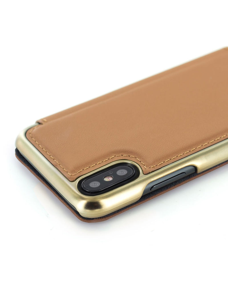 Detail image of the Greenwich Apple iPhone XS / X phone case in Saddle Brown