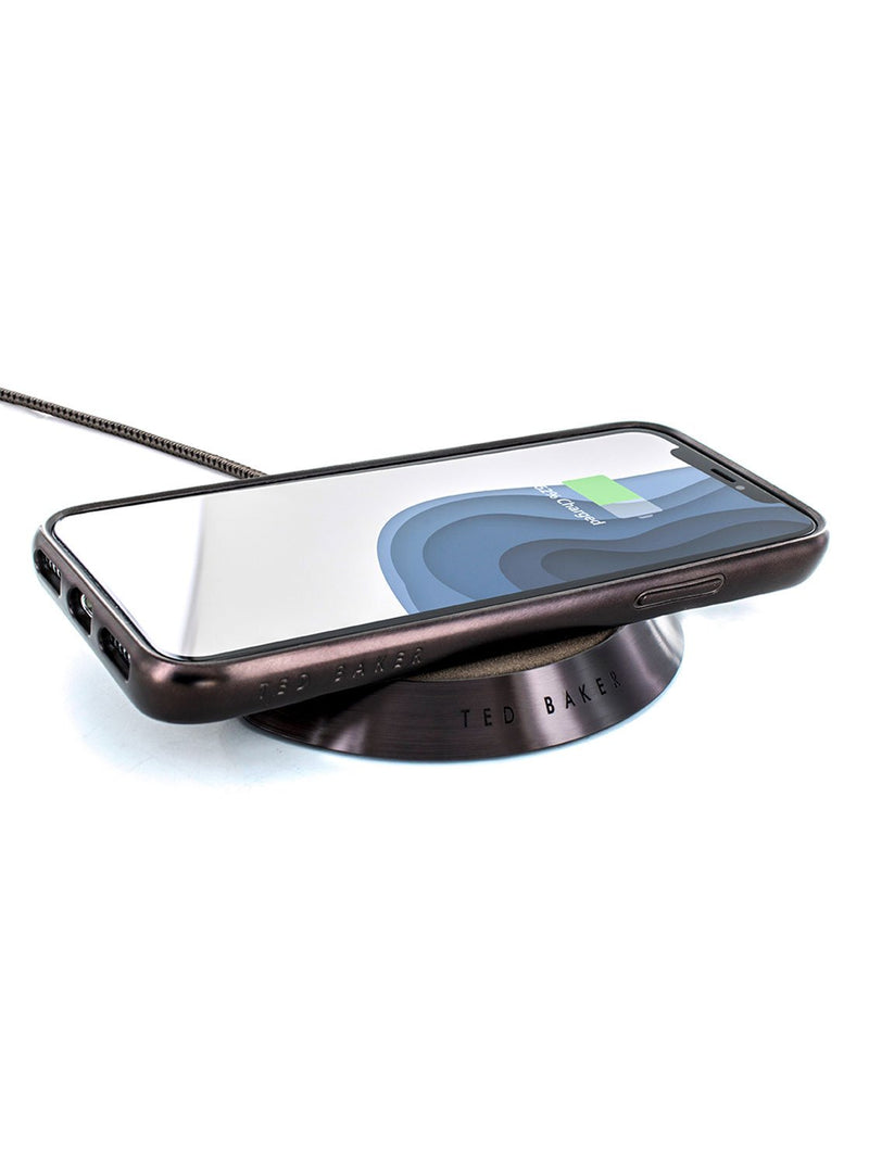With compatible device image of the Ted Baker Universal wireless charger in Brown