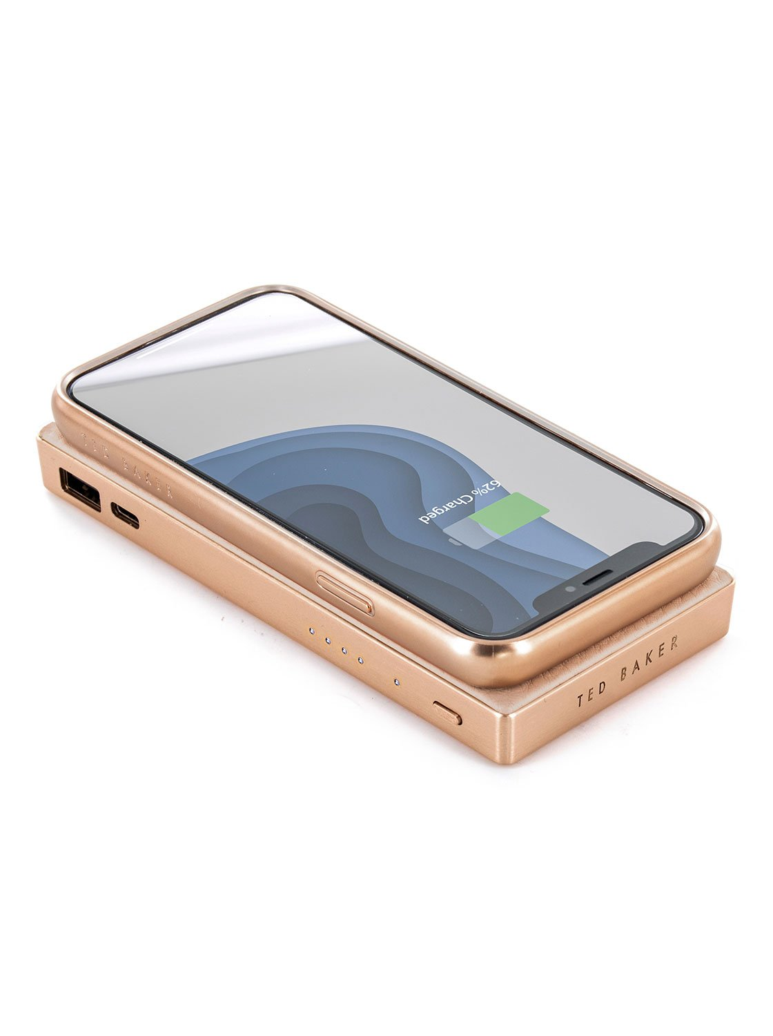 With compatible device image of the Ted Baker Universal wireless charger in Taupe
