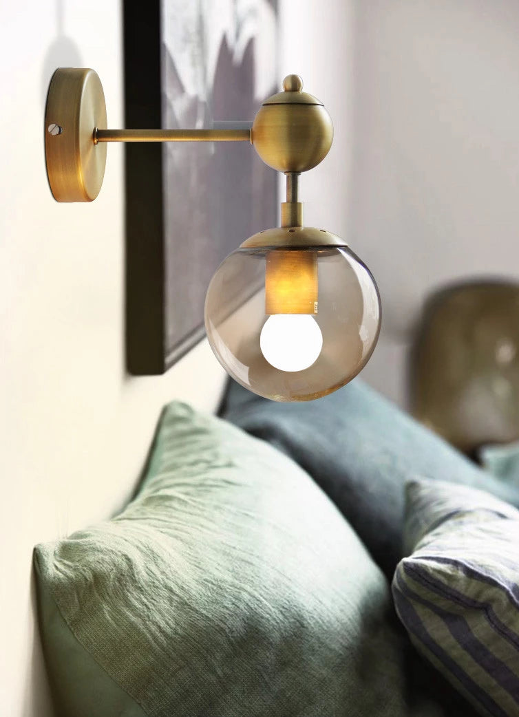 Lifestyle image of the nordic modern wall lamp as bedside lighting. Effortlessly elegant, the Nordic Modern Wall Lamp will add a finishing touch to both classic and contemporary living space