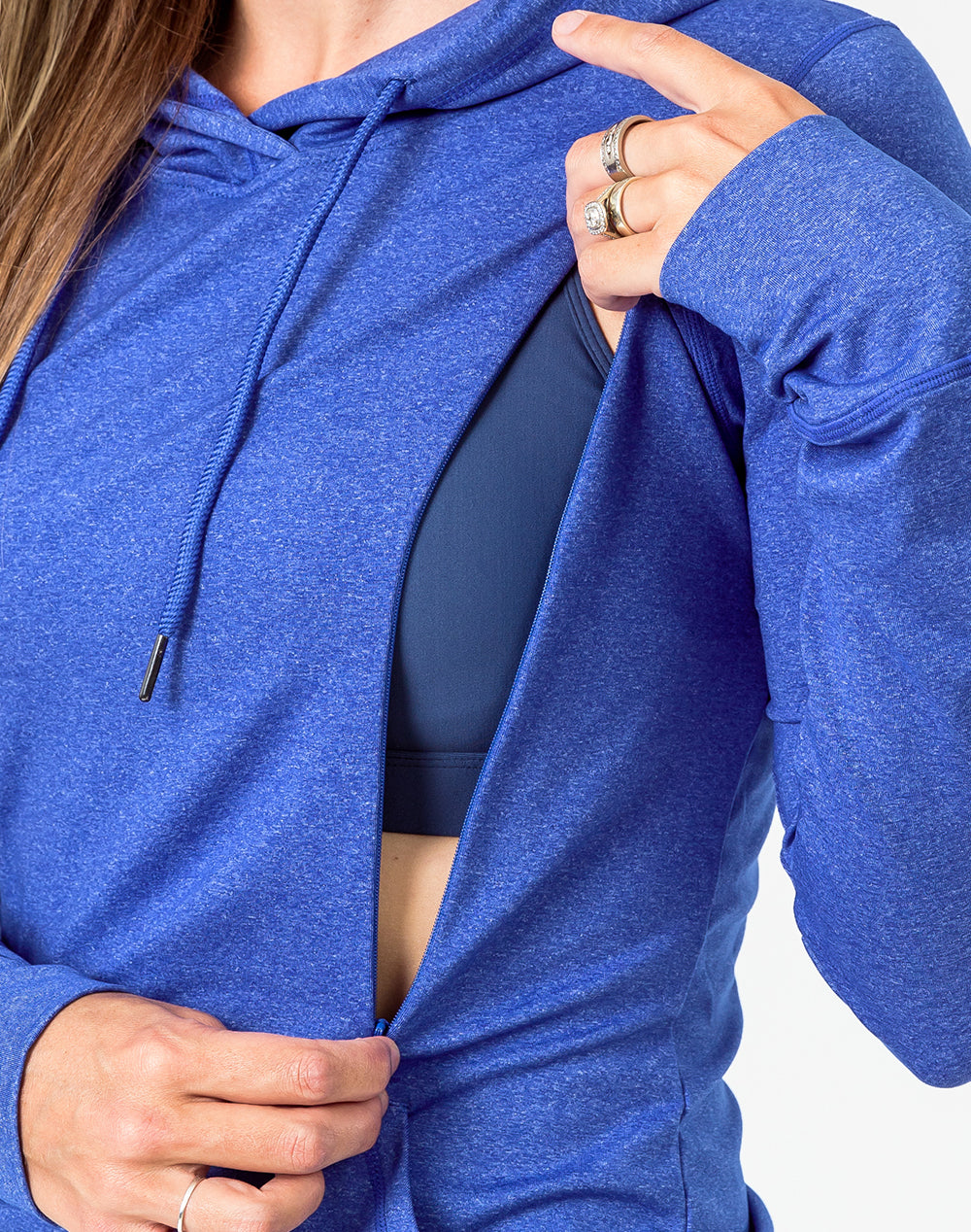 close up of a blue breastfeeding hoodie with the zip open for breastfeeding