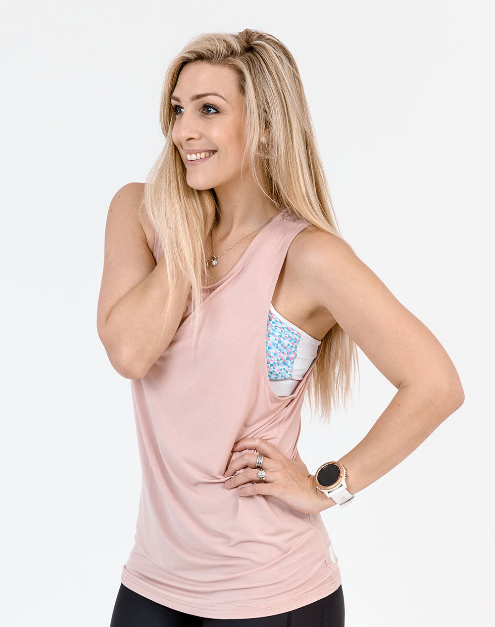 active mum wearing a blush colour breastfeeding top casual tank