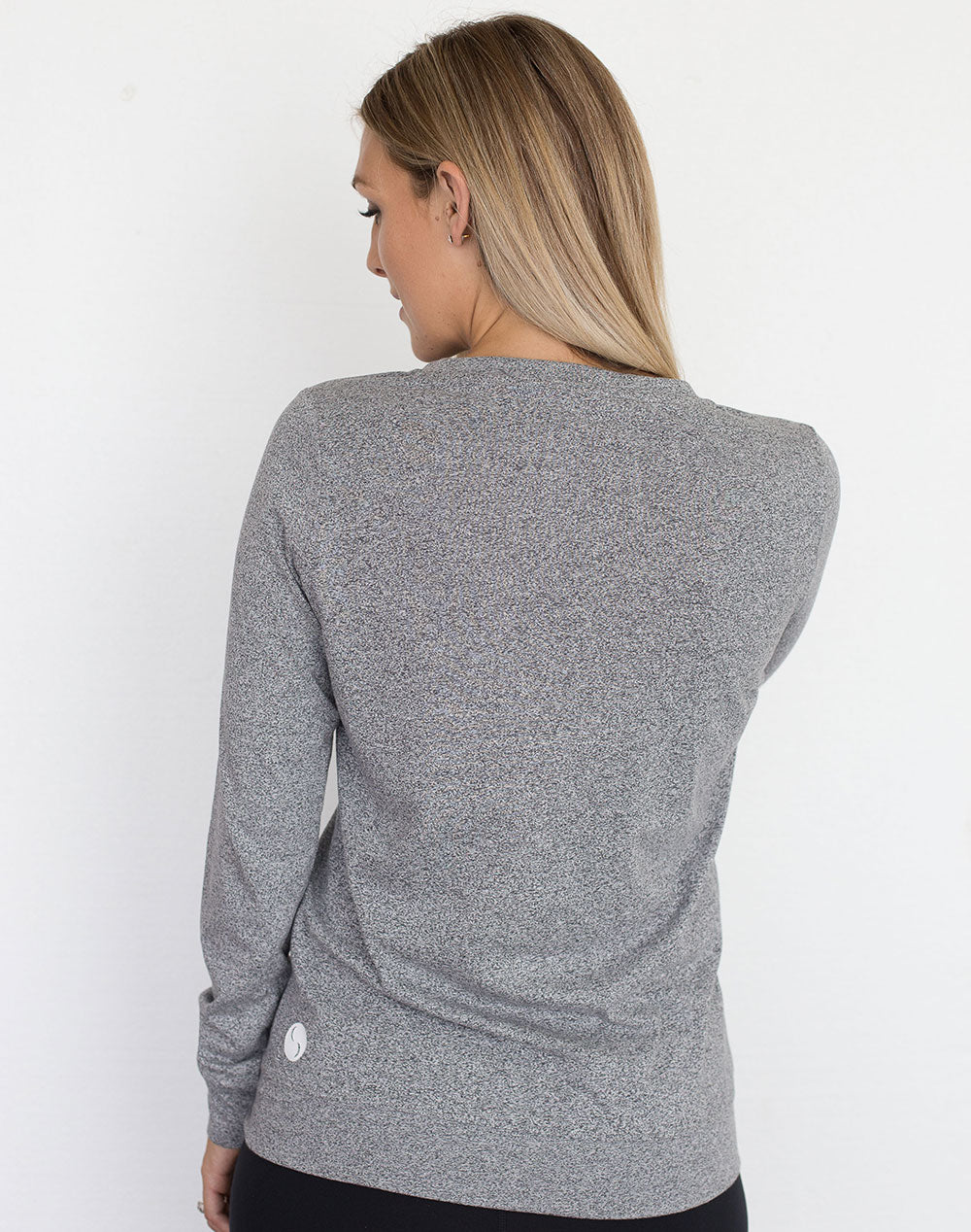 back view of a mum in a grey crew neck maternity top