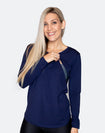 fit mother wearing a stylish blue maternity top with scooped hem