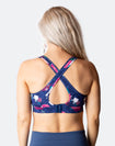 back view of a floral crossover nursing sports bra