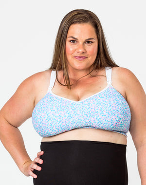 front view of a pregnant woman wearing a plus size nursing bra in an H cup size