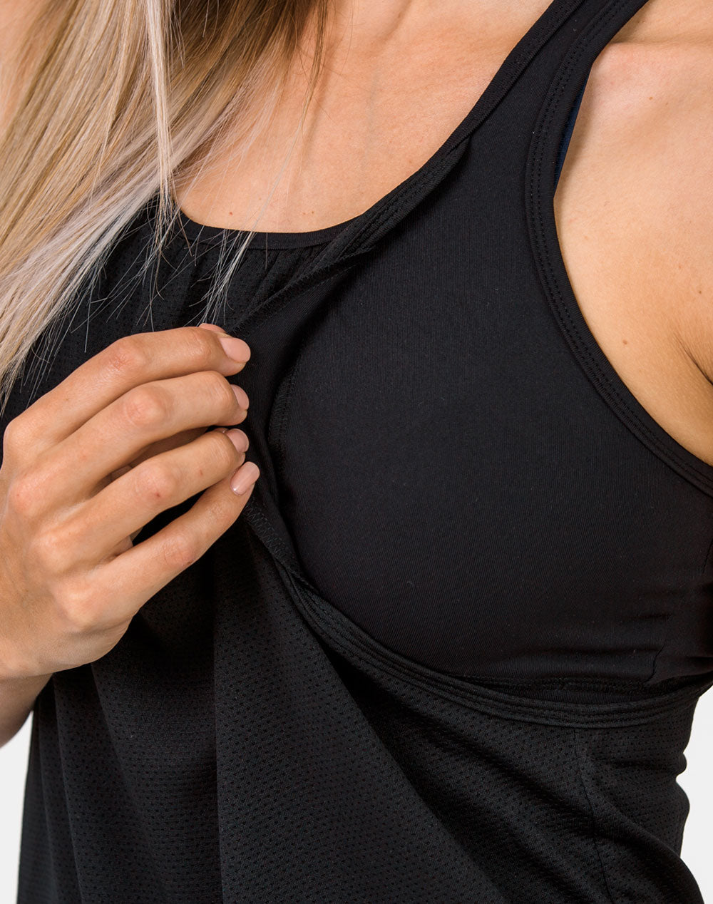 mum in a black breastfeeding top close up with the armhole pulled open to breastfeed