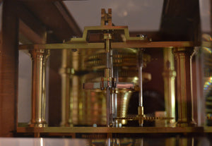 Mahogany Four Glass Library clock by Cousens and Whiteside of London.