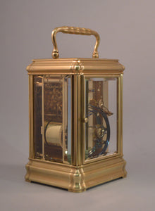 Carriage clock with engraved dial mask by Drocourt.