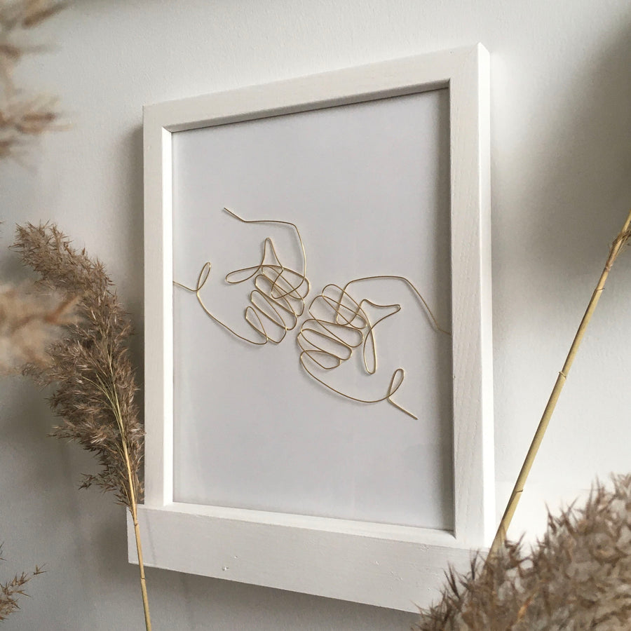 Fist Bump wire art - white frame lifestyle