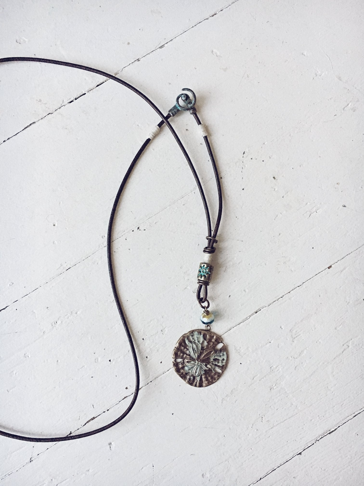 sand dollar boho beach style leather necklace - Peacock & Lime