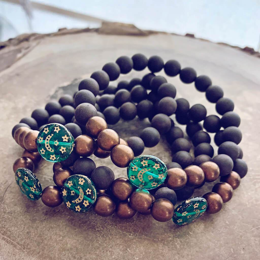 tranquility // black sandalwood and czech glass bracelet with emerald green moon & stars bead - Peacock & Lime , the original Peacock and Lime boho jewelry