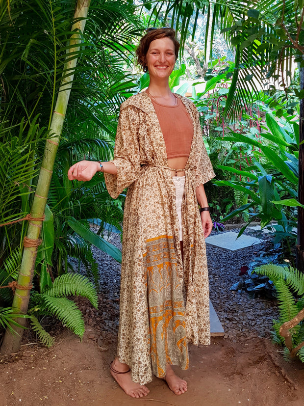 Earth friendly yet affordable fashion. Mamma Nomad creates with ethical values. Beautiful Flowing Boho chic Kimono made from recycled fabrics.