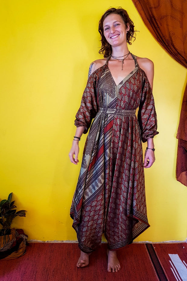 This beautiful gypsy style jumpsuit is made from recycled fabrics. Mamma Nomad makes clothing with Ethical and environment friendly values. Sustainable colorful fashion. Size XS to XXL.