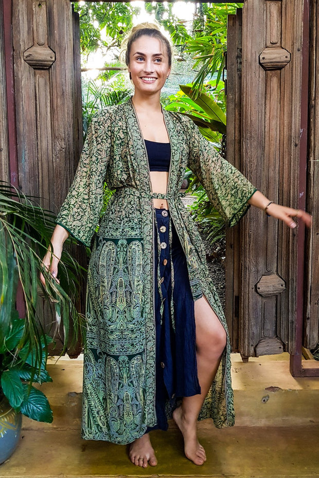Beautiful Green Bohemian style Kimono. Flowy and Elegant. Created with Ethical & Eco-friendly values by Mama Nomad. Colorful sustainable fashion. Yet affordable.