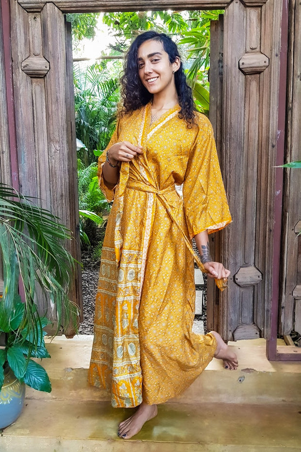Beautiful Orange Bohemian style Kimono. Flowy and Elegant. Created with Ethical & Eco-friendly values by Mama Nomad. Colorful sustainable fashion. Yet affordable.