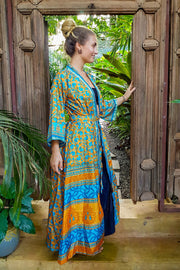 Funky Blue, Orange Bohemian style Kimono. Flowy and Elegant. Created with Ethical & Eco-friendly values by Mama Nomad. Colorful sustainable fashion. Yet affordable.