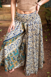 Mamma Nomad creates with ethical and environmental values. Eco-friendly clothing. Super comfortable and amazing to dance with.  These beautiful hippie pants are made from recycled fabrics.
