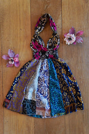 Eco friendly fashion for children: colorful boho dress made from recycled fabrics