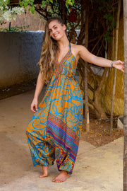 Bohemian Orange harem jumpsuit made from recycled fabric by Mamma Nomad. Eco-friendly, Sustainable & Ethical clothing.