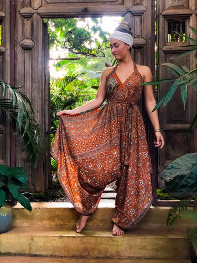 Bohemian Airy Orange Jumpsuit made of recycled fabrics. Size XS to XL. Mama Nomad creates with ethical & eco-friendly values