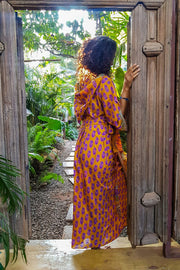 Long orange and purple kimono dress made from repurposed fabrics. Mamma Nomad: Sustainable yet Affordable handmade Fashion