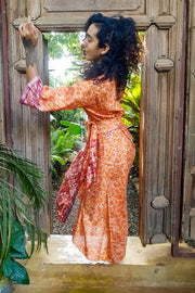Long Orange and Red kimono dress made from repurposed fabrics. Mamma Nomad: Sustainable yet Affordable handmade Fashion