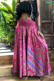 Pink hippie pants skirt. Mama Nomad makes these garments from recycled fabrics. Beautiful gypsy flowey pants that look like a skirt! We create the clothing with environment & ethical friendly values.