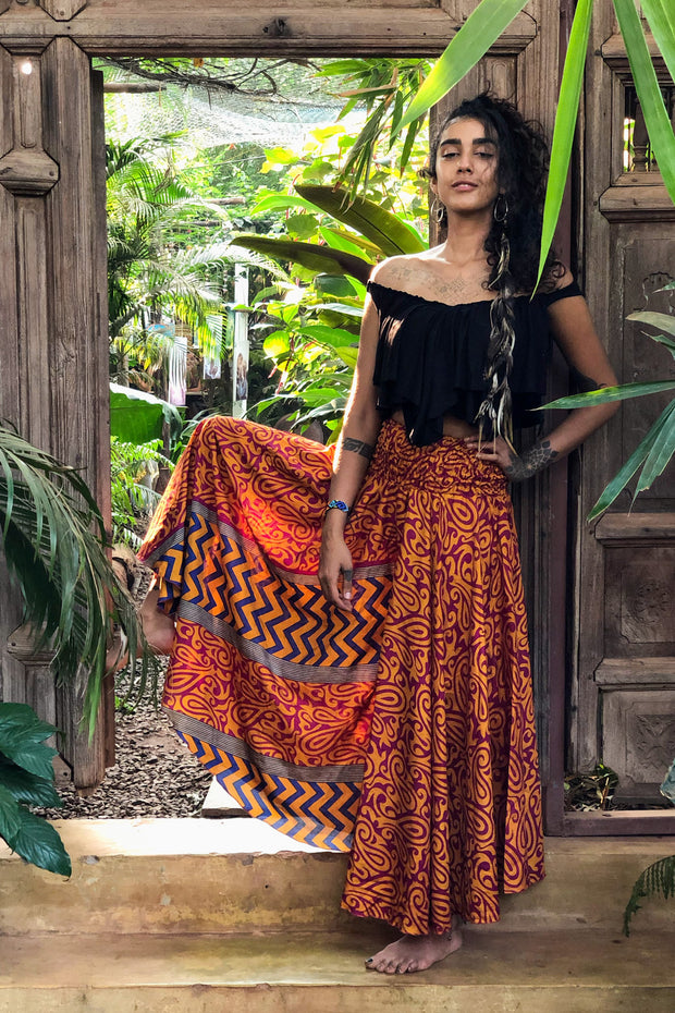 Orange hippie pants slash skirt. Mama Nomad makes these garments from recycled fabrics. Beautiful gypsy flowy pants that look like a skirt! We create the clothing with environment & ethical eco friendly values.