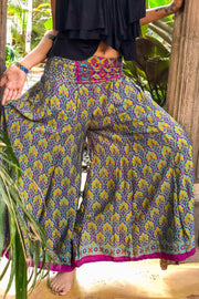 Epic Hippie Flower Power pants slash skirt made from recycled fabrics. Mamma Nomad; sustainable yet affordable fashion.