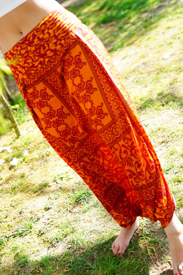 Beautiful Orange and Red handmade harem pants skirt with print. Made from recycled fabrics. Mamma Nomad: Sustainable fashion